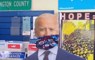 Picture of Joe Biden cutout wearing themed mask