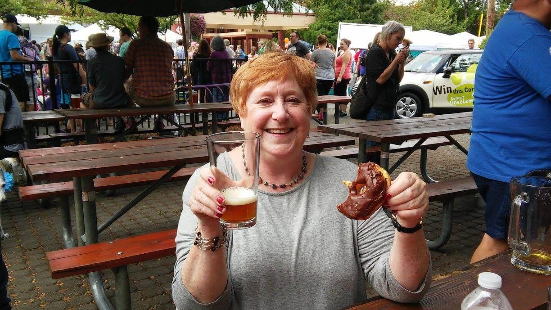 Margaret Enjoying Post Parade Beer in Multnomah Village
