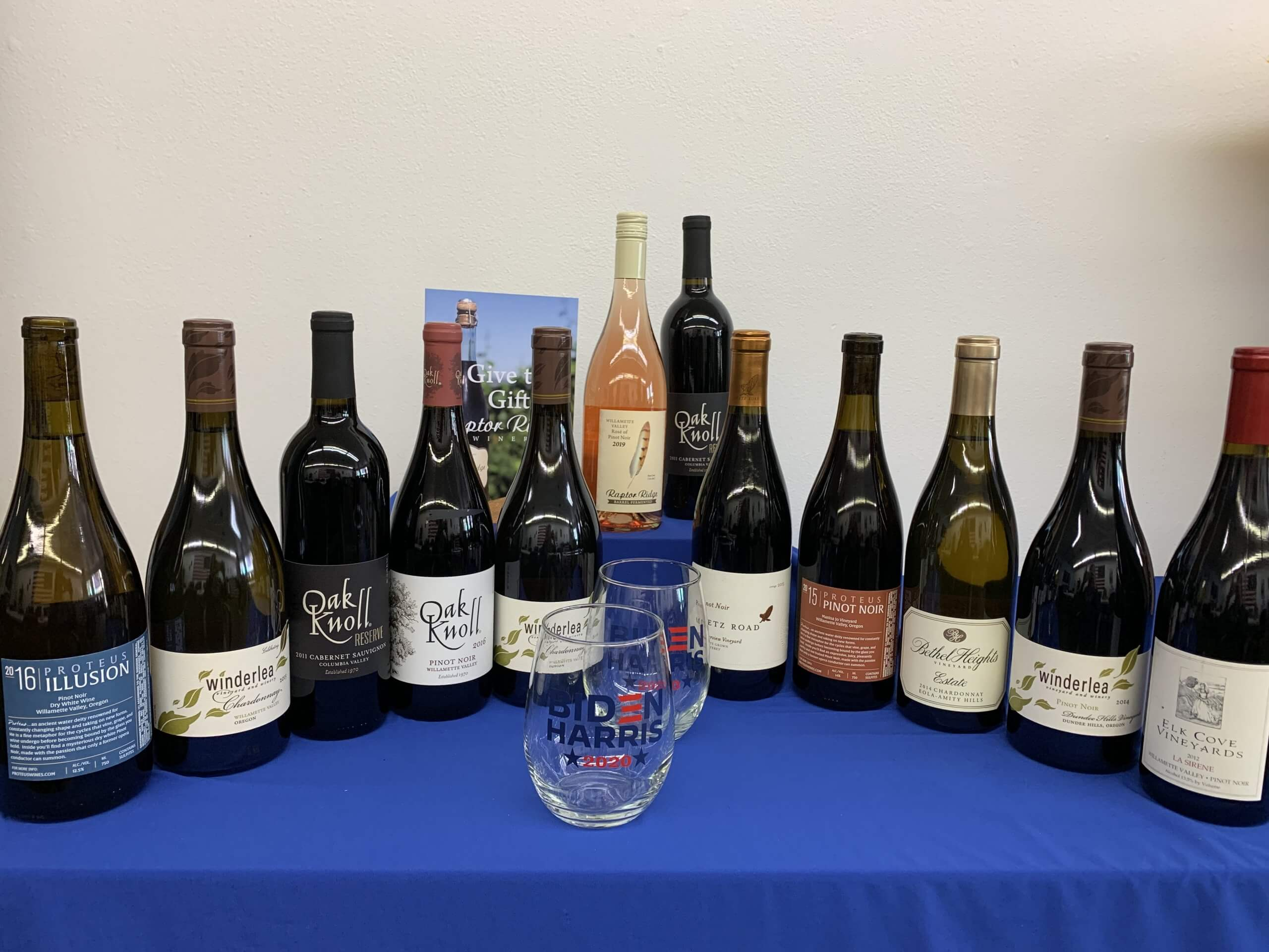 image of 12 wine bottles and two wine glasses