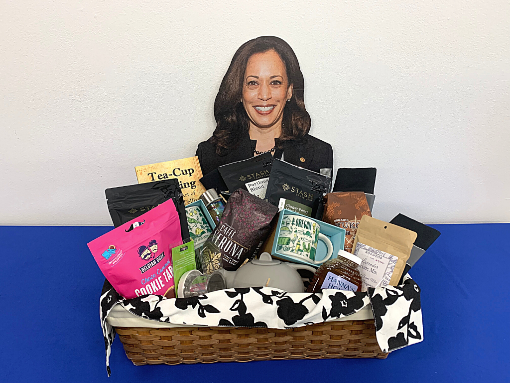 photo with assortment of coffe and tean goods with a kamala harris cut out in the background