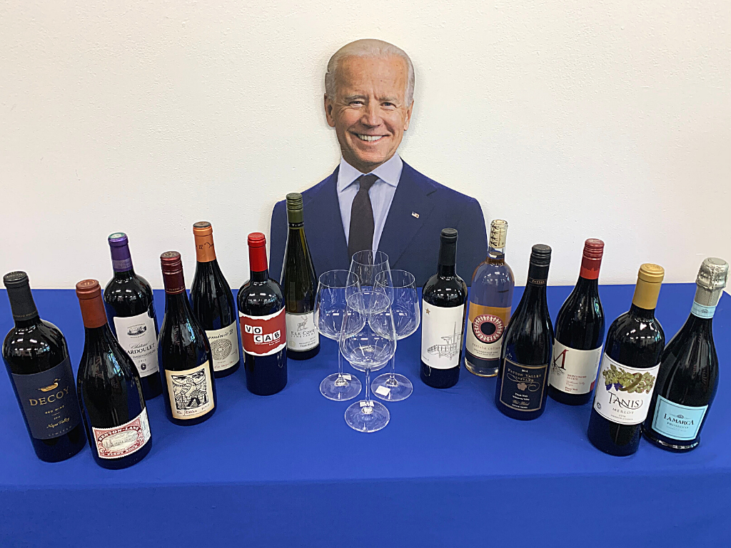 photo with an assortment of wine with a cut out of joe biden in the background