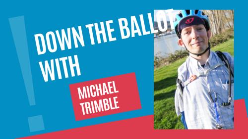 Candidate Michael Trimble next to Williamette river in bike helmet smiling